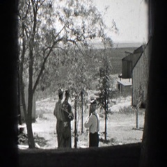 1937: three people standing on the premises of a building CALIFORNIA Stock Footage
