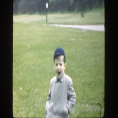 1949: little boy posing for a silly picture. CINCINNATTI OHIO Stock Footage