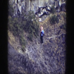 1937: topless man descending down hilly area CALIFORNIA Stock Footage
