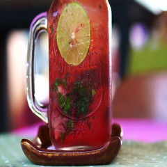 Fresh summer drink red strawberry, lemon and mint serve in mason jar Stock Footage