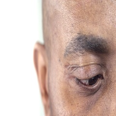 Extreme Close-Up of a Brown Eye of an Afro-American Man Stock Footage