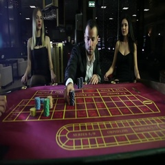 Two brutal men play at the Casino, surrounded by girls Stock Footage