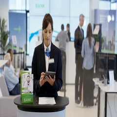 4K Friendly bank worker talking to customer as seen from customer's pov Stock Footage