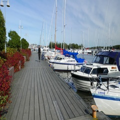 Cheerful woman stroll at planked pier, happy walk towards beside parked yachts Stock Footage