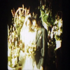1939: a young attractive couple pose for photos on their wedding day MONTANA Stock Footage