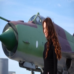Hairy brunette turn back against military fighter jet, slow motion Stock Footage