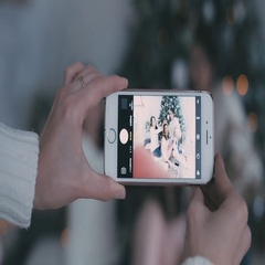 Taking a photo smartphone girls on the background of Christmas tree Arkistovideo