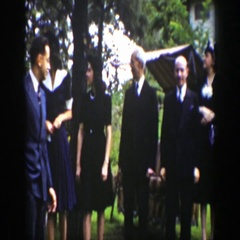 1939: a group of people dressed nice gathered outside WYOMING Stock Footage