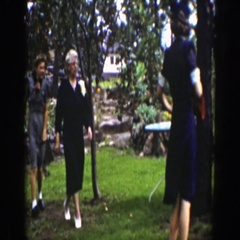 1939: a small group of people walking through a park like area WYOMING Stock Footage