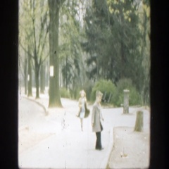 1949: girl and boy walking in a park CINCINNATTI OHIO Stock Footage