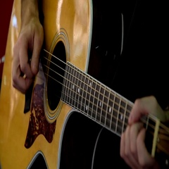 Man plays acoustic guitar Stock Footage