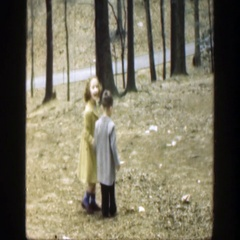 1949: two children holding hands walking outside. CINCINNATTI OHIO Stock Footage