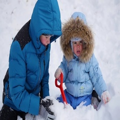 A happy children plays with snow in the park. buried in the snow Stock Footage