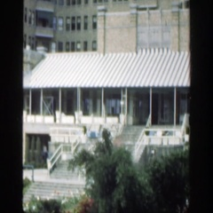 1949: a well-kept garden on the lawn of a large building CINCINNATTI OHIO Stock Footage