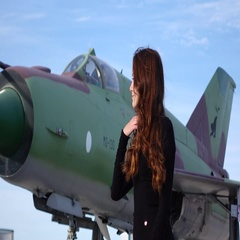 Optimistic woman portrait, lady stand against museum military airplane Stock Footage