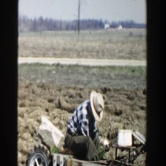 1954: the farmers ploughing the land with a tractor for farming WISCONSIN DELLS Stock Footage