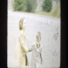 1949: little boy and girl running down driveway, playing. CINCINNATTI OHIO Stock Footage