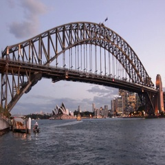 Sydney Trains pass over the Sydney Harbour Bridge Stock Footage