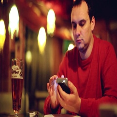 Man with smartphone drinking beer and reading or sending message at bar or pub Stock Footage