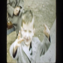 1949: child in park walking towards camera rubbing his face  Stock Footage