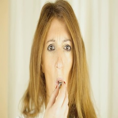 Whistle blowing woman serious front Stock Footage