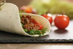 Homemade tortilla with beef, frillice and vegetables, organic fastfood Stock Photos