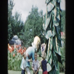 1954: a children standing next to a statue that moves with blonde hair WISCONSIN Stock Footage