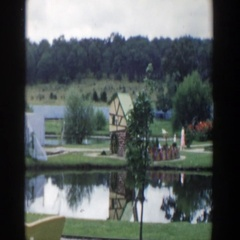 1954: woman and child strolling in a lovely park with a small pond. WISCONSIN Stock Footage