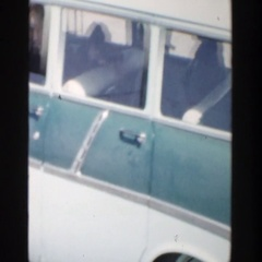 1956: man trying to communicate outside of his car window. GRAND RAPIDS MICHIGAN Stock Footage