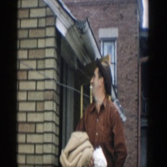 1957: a man gathers his belongings and leaves his house MICHIGAN Stock Footage