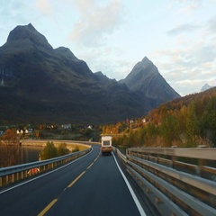 Driving on route E8 toward the city of Tromso, on a nice evening sunset, in n Stock Footage