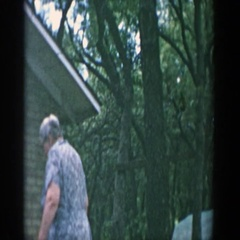 1957: a grandmother moving something away from three young children WISCONSIN Stock Footage