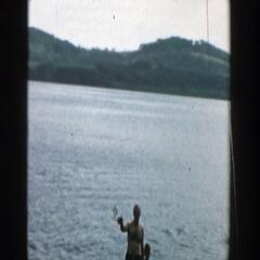 1957: fun times with grandpa in the lake! WISCONSIN Stock Footage