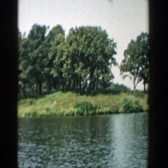 1957: a brief picture of a young lad rowing his boat across the english bay. Stock Footage