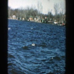 1957: body of water with rolling, choppy waves and a neighborhood  Stock Footage