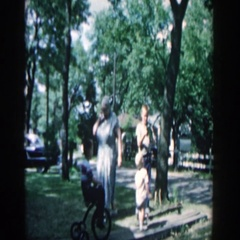 1957: children gathered around toy in front yard. WISCONSIN Stock Footage