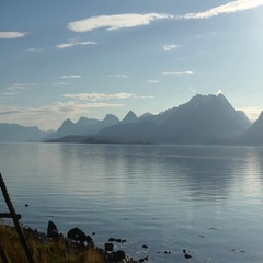 Pan view on lofoten fjords and mountains, on the road from Tromso to Alta, in Stock Footage