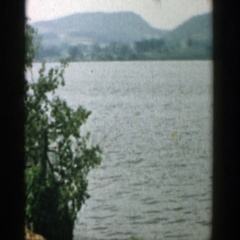 1957: a large lake or river with a few swimmers WISCONSIN Stock Footage