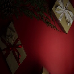Top view hands holding christmas presents on red background from above. Gift Stock Footage