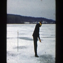 1957: a man wearing black dress and with cap is placing something  Stock Footage