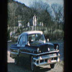 1957: a black color old fashioned royal sedan being parked along the roadside Stock Footage