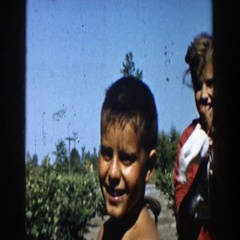 1958: girl wipes hands and poses with two boys MICHIGAN Stock Footage
