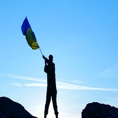 Soldier  waves Ukrainian Flag  against blue sky .Slow  motion Stock Footage