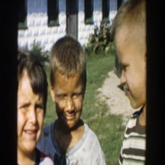 1958: three boys who have been playing in the mud tell their story. MICHIGAN Stock Footage