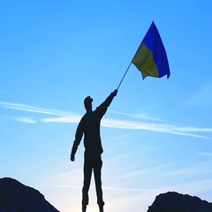 Waves Ukrainian Flag  and Silhouette of Soldier against blue sky .Slow Motion  Stock Footage