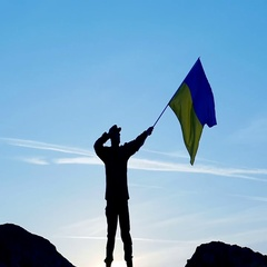 Soldier  salute Ukrainian Flag  against blue sky .Slow  motion Stock Footage