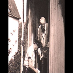 Vintage 16mm film, 1967, cleaning up after house fire Stock Footage
