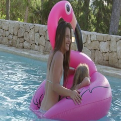 Mother And Daughter On Inflatables In Outdoor Swimming Pool Stock Footage