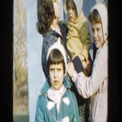 1958: children and their mother all standing around outside. MICHIGAN Stock Footage