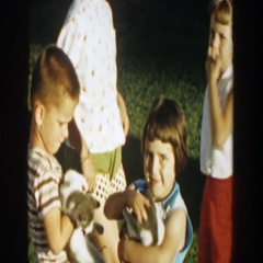 1958: mom introduces kids to the new kittens. MICHIGAN Stock Footage